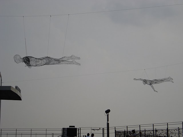 swimming wire sculptures next to Seoul Tower on top of Namsan