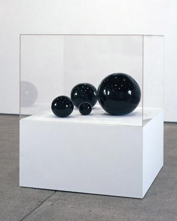 Black Balls, glazed ceramic sculpture 2008 by David Shrigley