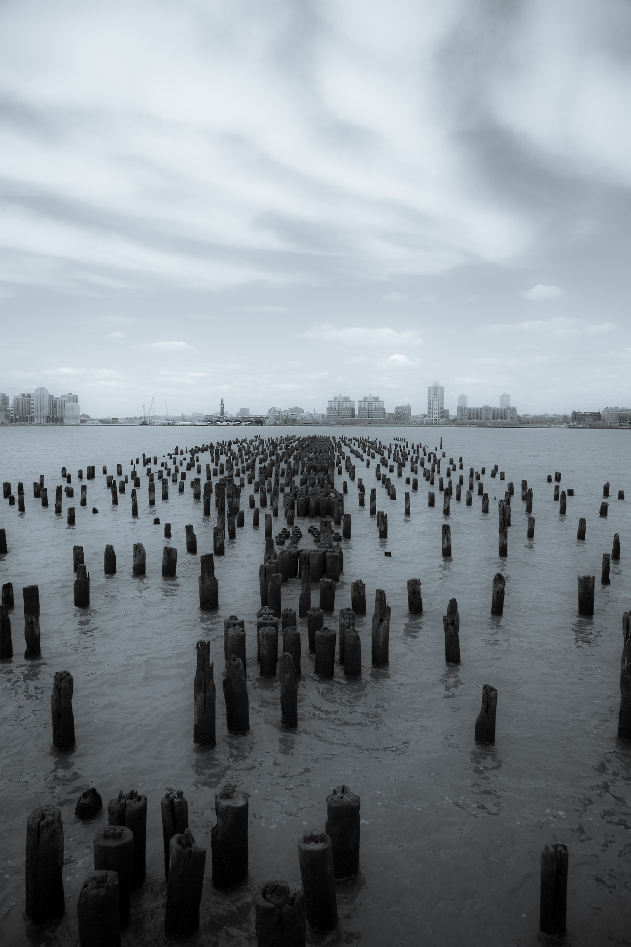 Old pier pylons, Hudson River, photograph by Ric Camcho